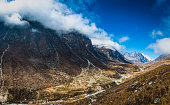 Clouds rolling over mountain peaks remote Sherpa valley Himalayas Nepal