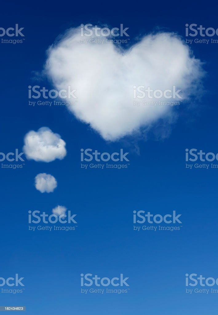 Clouds shaped like a heart and thought bubble royalty-free stock photo