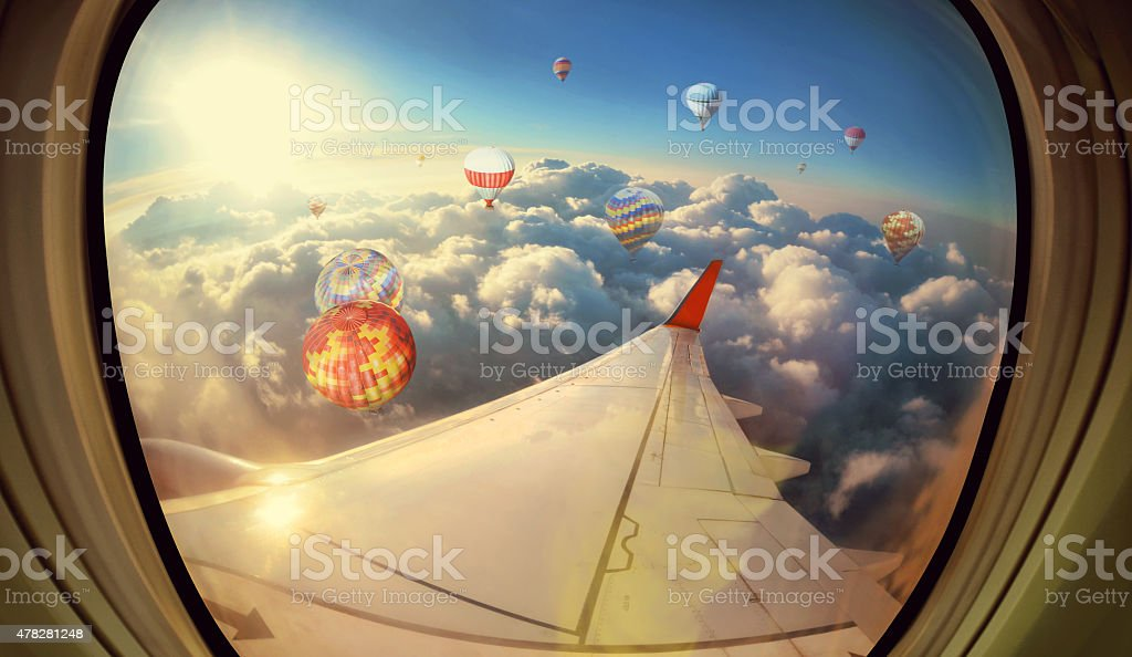 Clouds ,sky and Balloons as seen through window of  aircraft stock photo