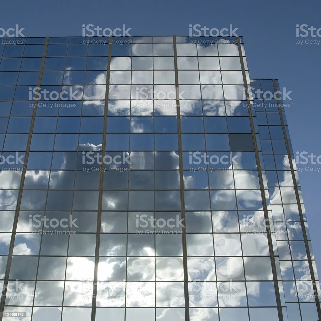 Clouds & sun reflected in windows royalty-free stock photo