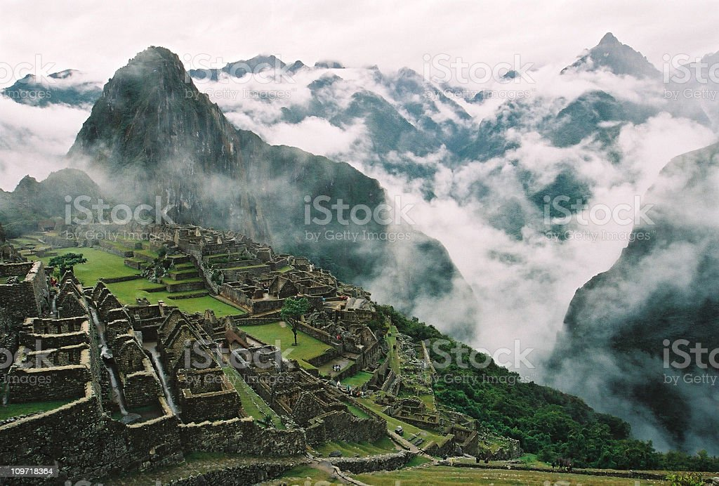 Clouds Surrounding Machu Picchu and Inca Ruins stock photo