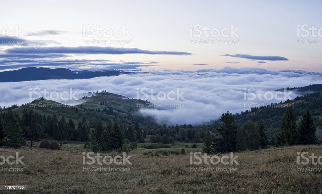 clouds under mountain royalty-free stock photo