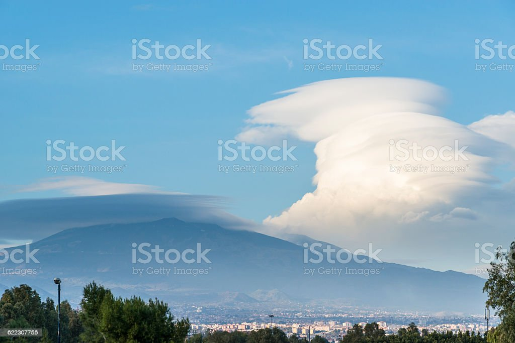 Clouds under the Mount Etna. Catania. Sicily. Italy. stock photo