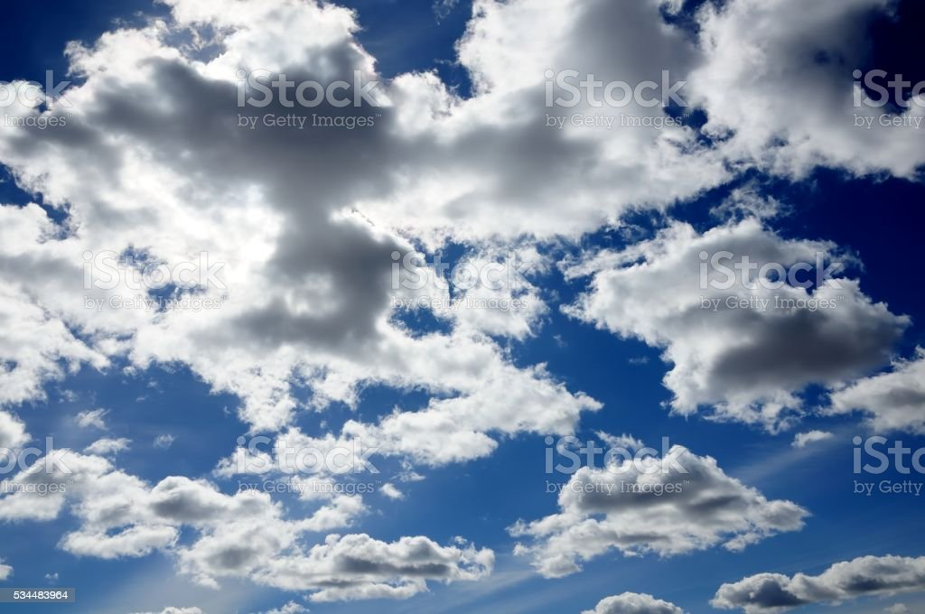 clouds with solar illumination in the blue sky stock photo