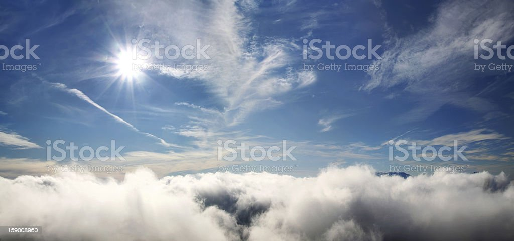 Clouds with the sun under tropical sea royalty-free stock photo