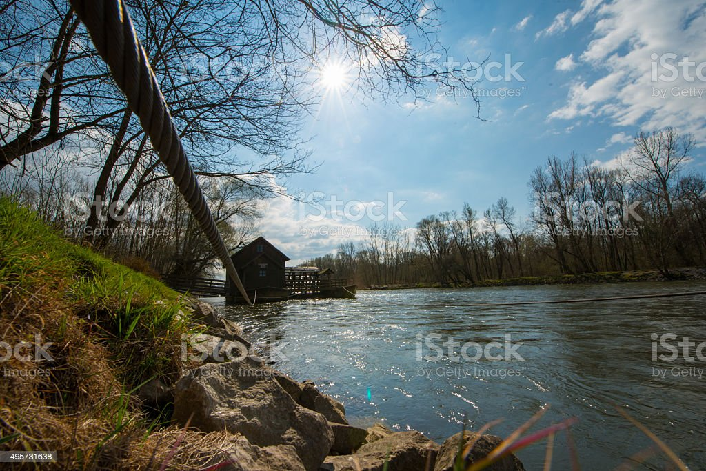 Cloudscape over a watermill on the Mur river stock photo