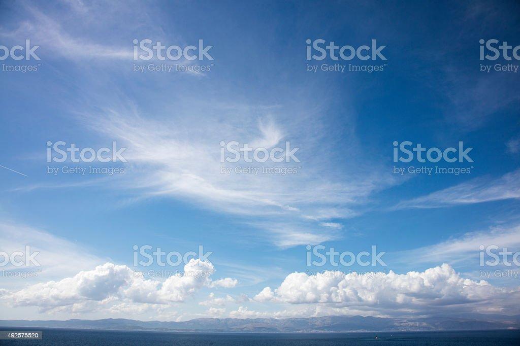cloudscape over the sea horizon stock photo