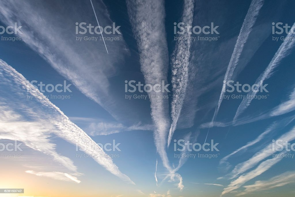 Cloudscape Showing Trails Left By Airplanes stock photo