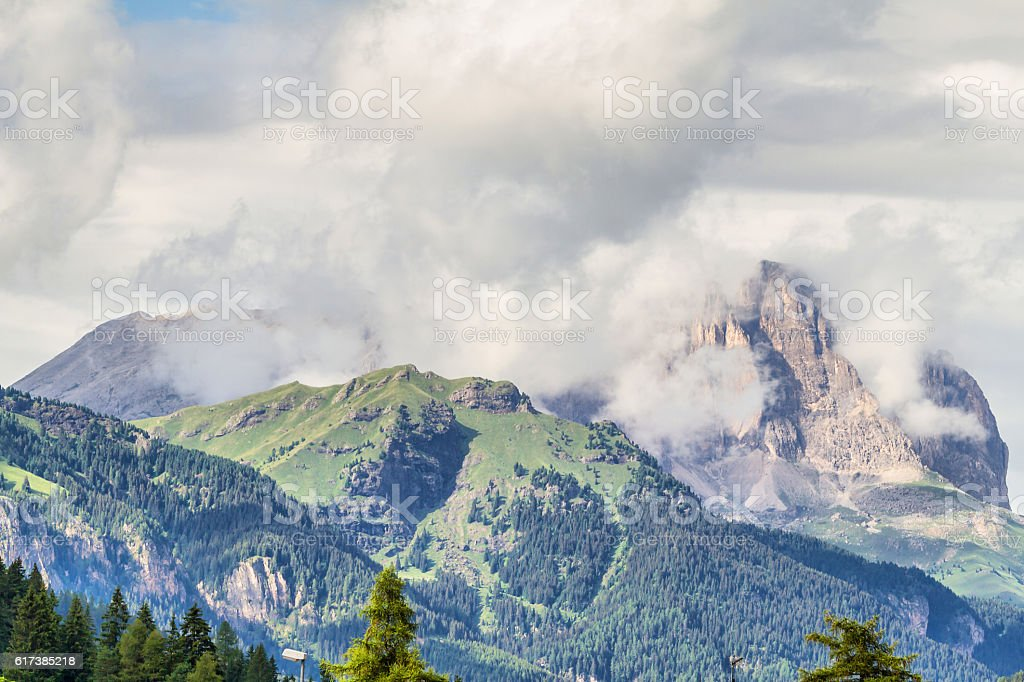 Cloudscape view of Sella Group mountains with clouds - Dolomites stock photo