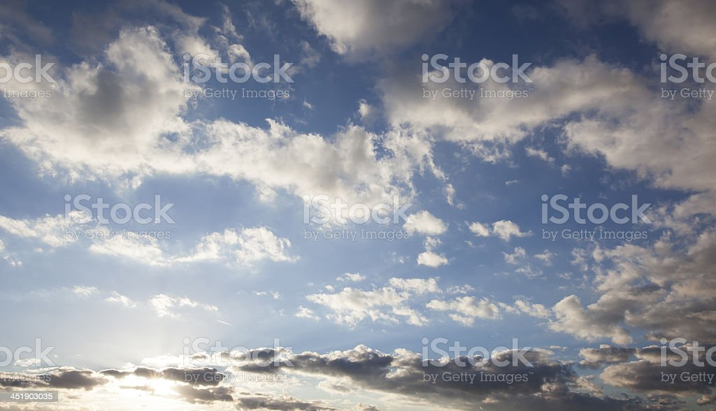 Cloudscape with afternoon shadows stock photo