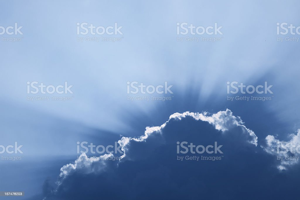 cloudscape with sun beams stock photo