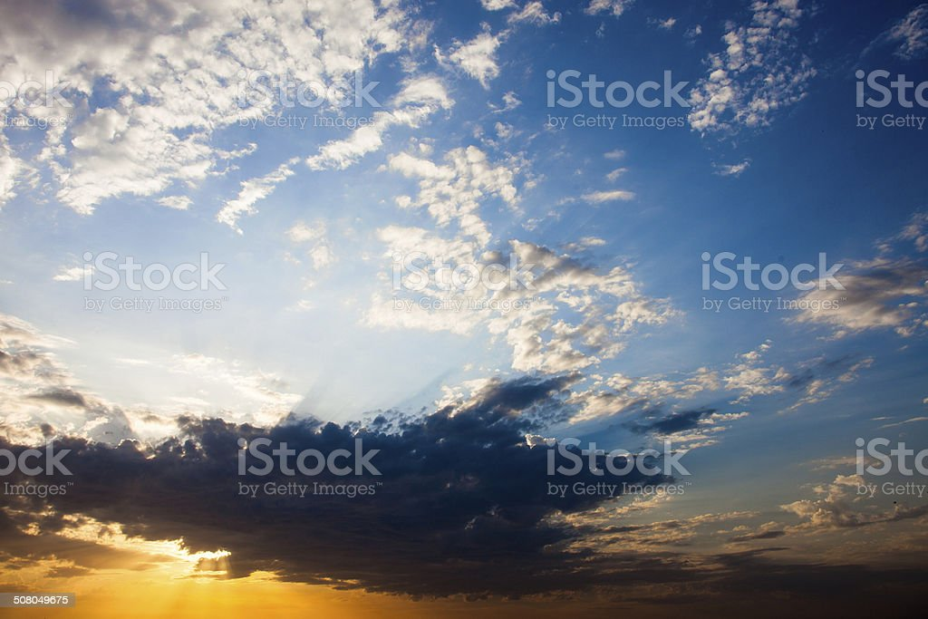 Cloudscape with the sun rays radiating from behind the cloud royalty-free stock photo