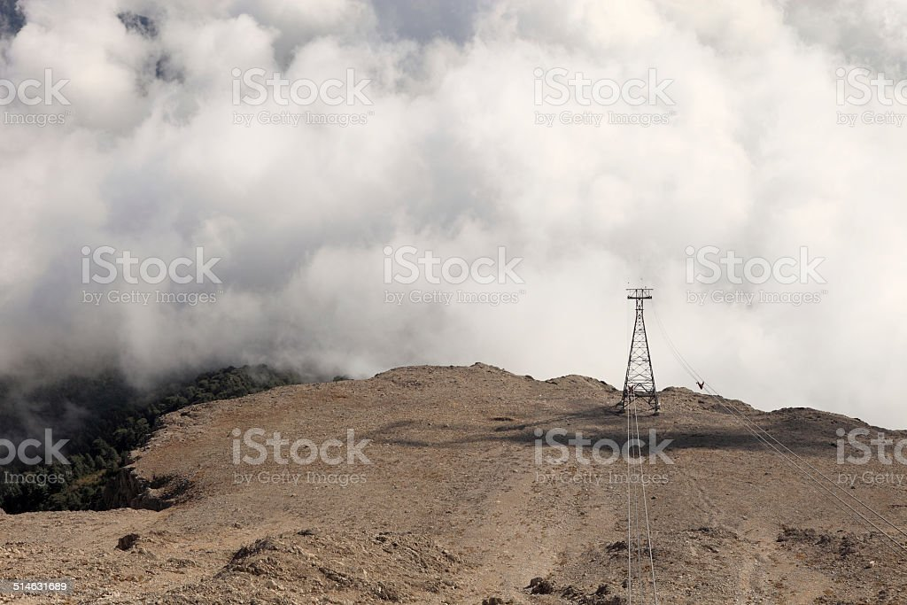 Clouds-covered high mountains stock photo