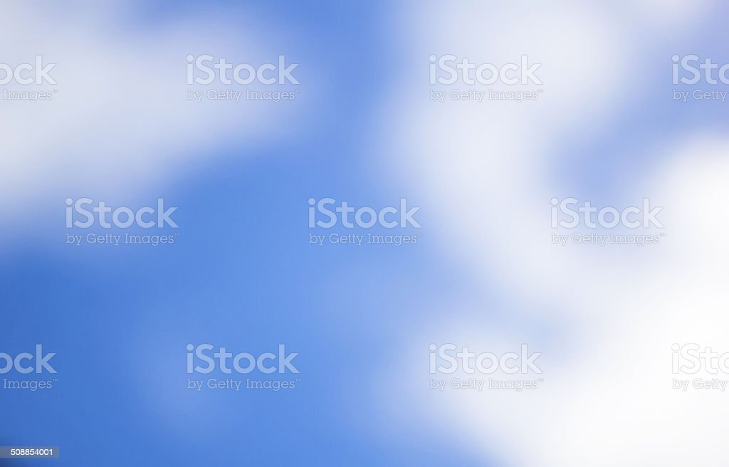 Cloudy and blue sky burred background vector art illustration
