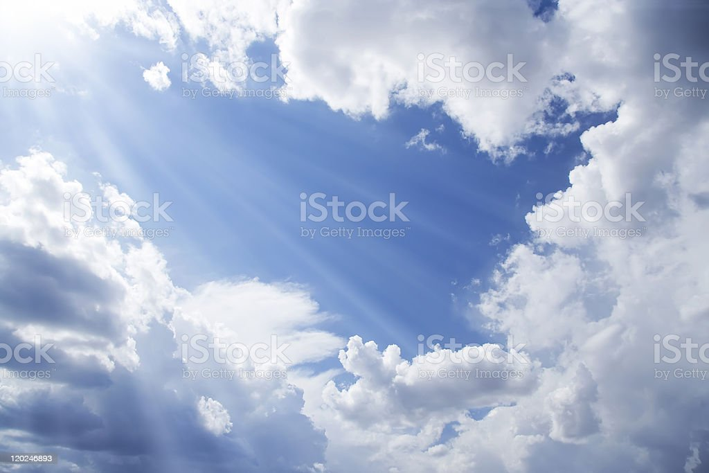 Cloudy blue sky and sun rays. royalty-free stock photo