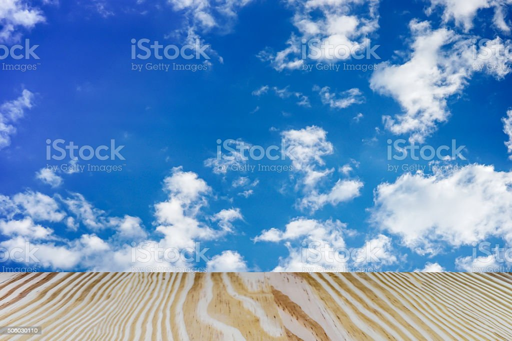 Cloudy blue sky and wood floor stock photo