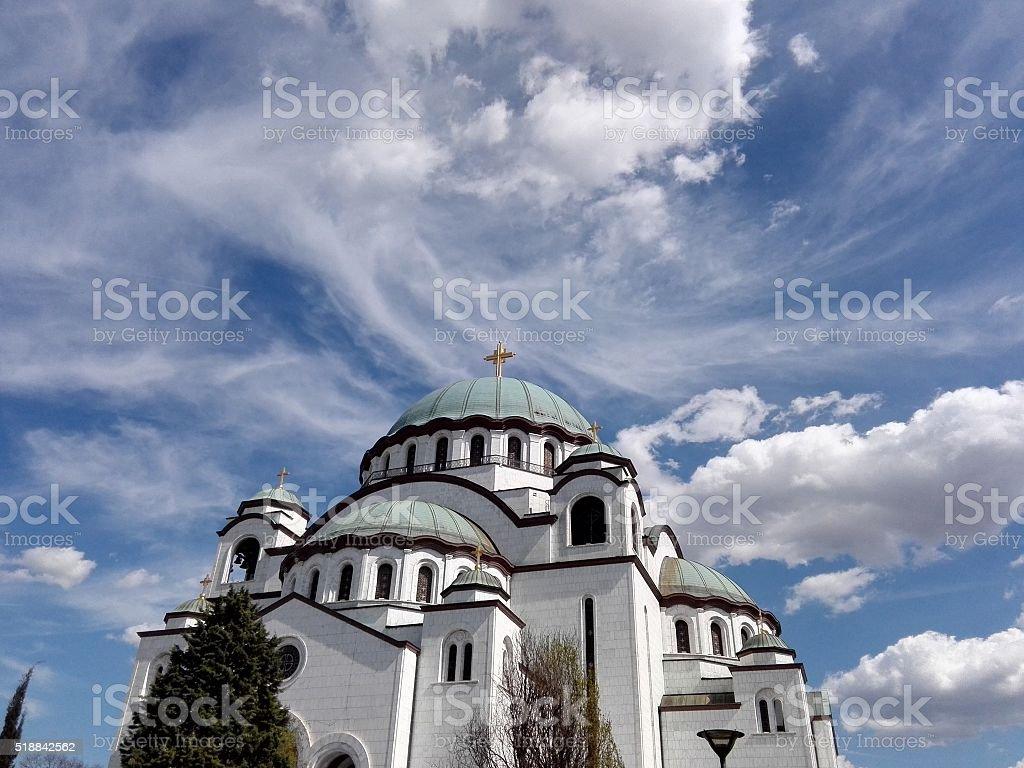 Cloudy blue sky over the Church stock photo