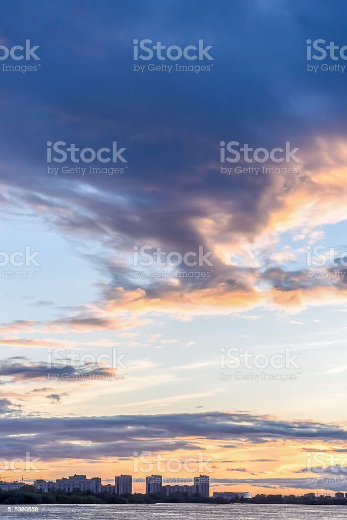 Cloudy heaven at the evening city-pond stock photo