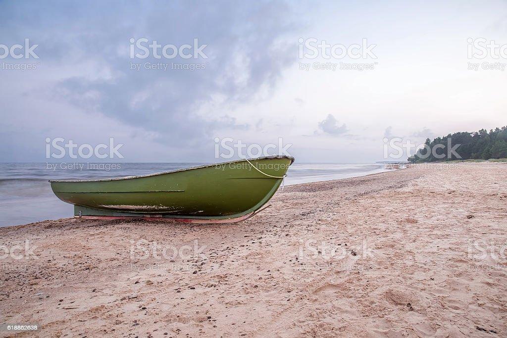 Cloudy morning. Fishing boat in the coast. Baltic sea. stock photo