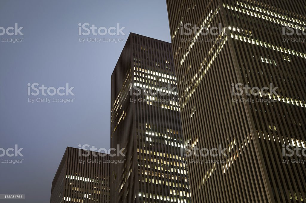 Cloudy nighttime skyscrapers royalty-free stock photo