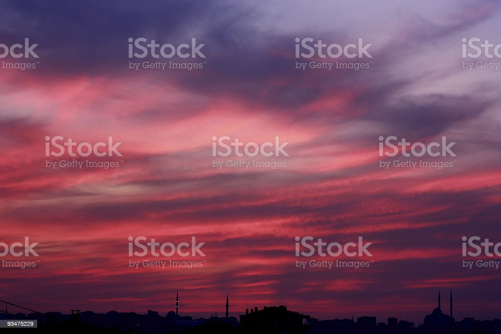 Cloudy red sunset scene with city silhouette royalty-free stock photo