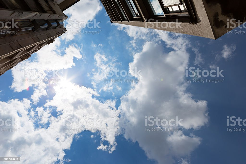Cloudy sky and high rise buildings stock photo