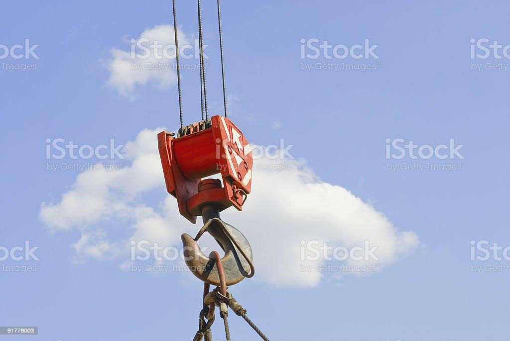 Cloudy sky and hook crane stock photo