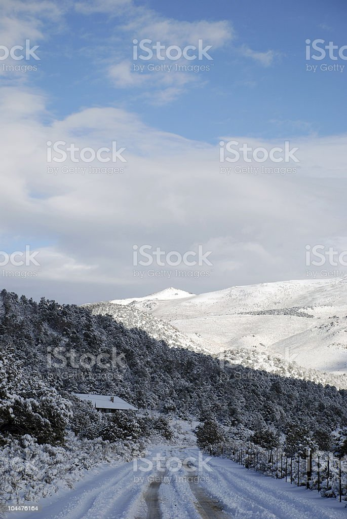 Cloudy Sky and Snow Covered Road royalty-free stock photo