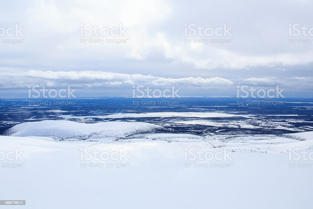 cloudy sky and winter mountain landscape above the Arctic Circle stock photo