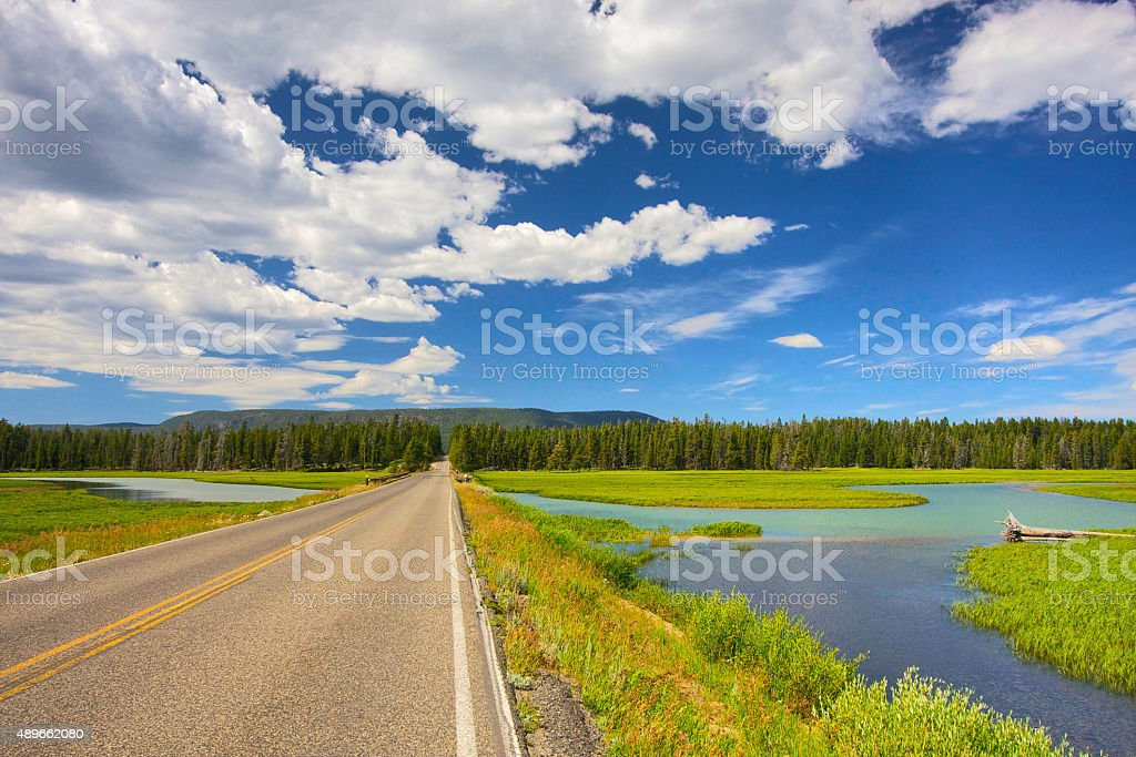 Cloudy sky over a road stock photo