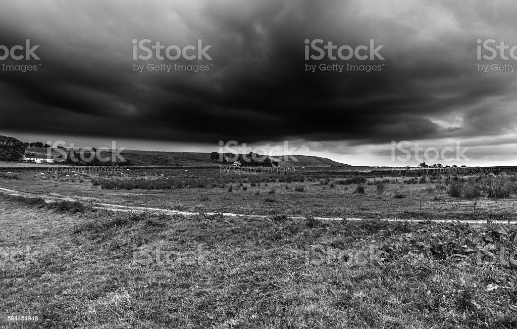 Cloudy Sky Over Countryside stock photo
