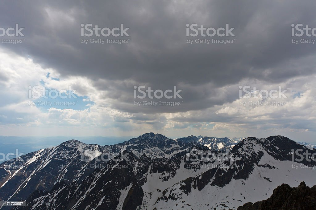 Cloudy sky over high mountains royalty-free stock photo