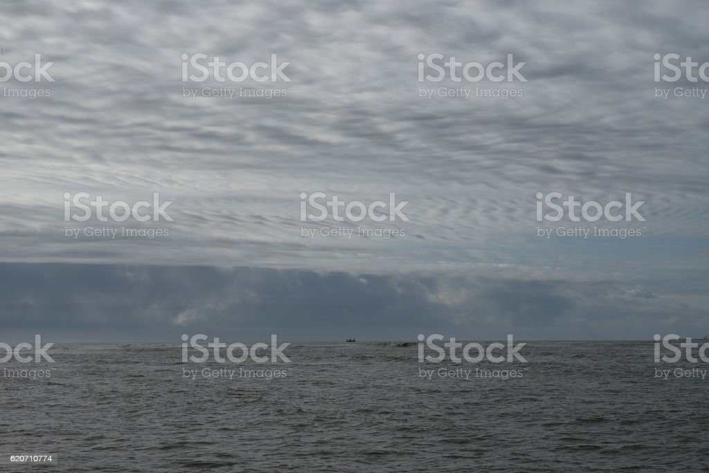 Cloudy sky over the sea stock photo