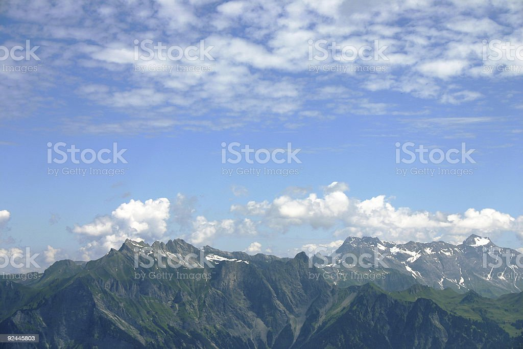 Cloudy sky over the swiss alps royalty-free stock photo