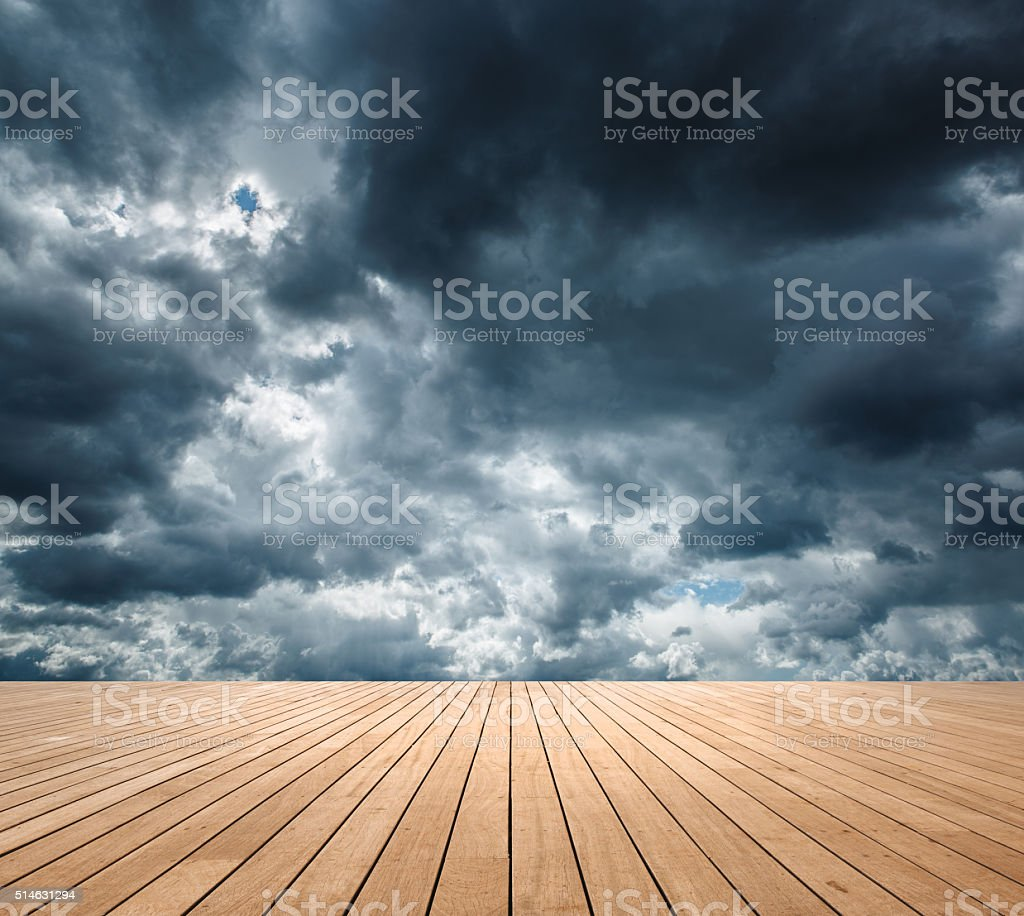 Cloudy sky with blank wood platform stock photo
