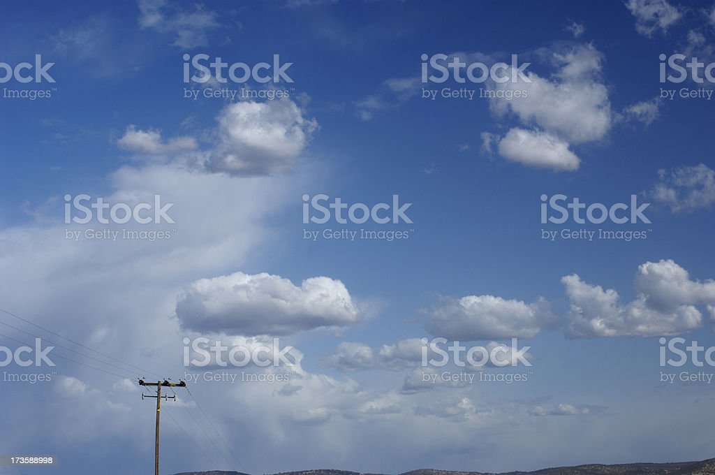 Cloudy Sky With Telephone Pole royalty-free stock photo