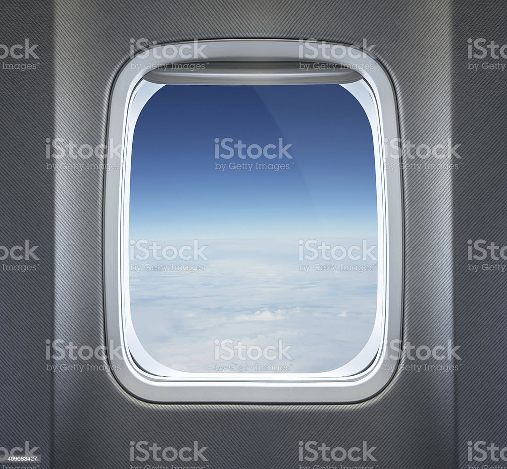 Cloudy skyline view from airplane window stock photo