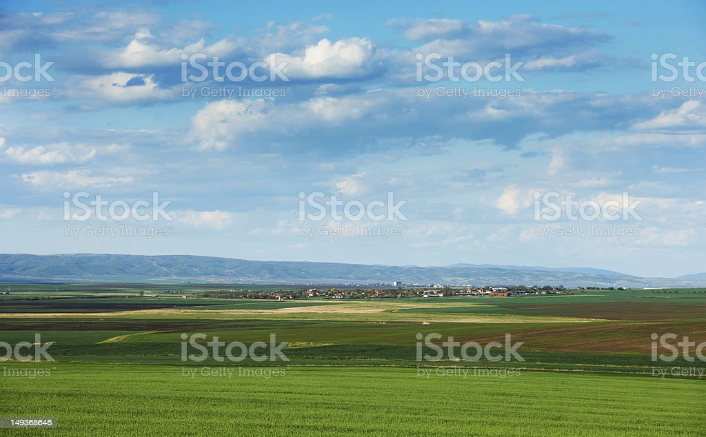 Cloudy spring landscape stock photo