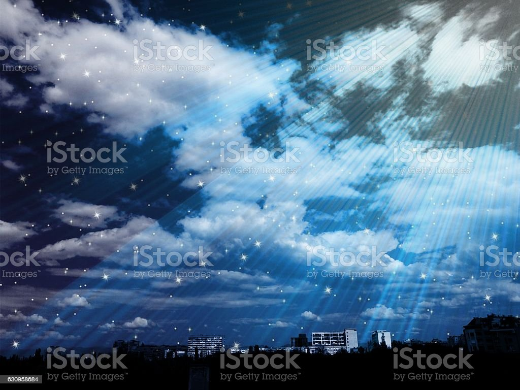 Cloudy starry night over the city stock photo