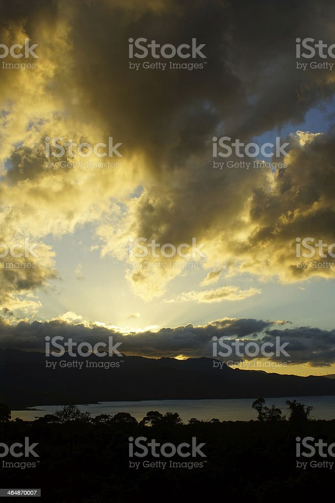 Cloudy sunset at Lake Arenal stock photo