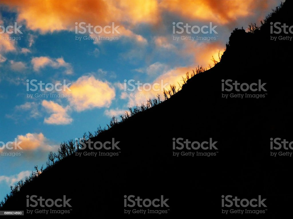 Cloudy sunset behind a mountain in Andes, Argentina stock photo