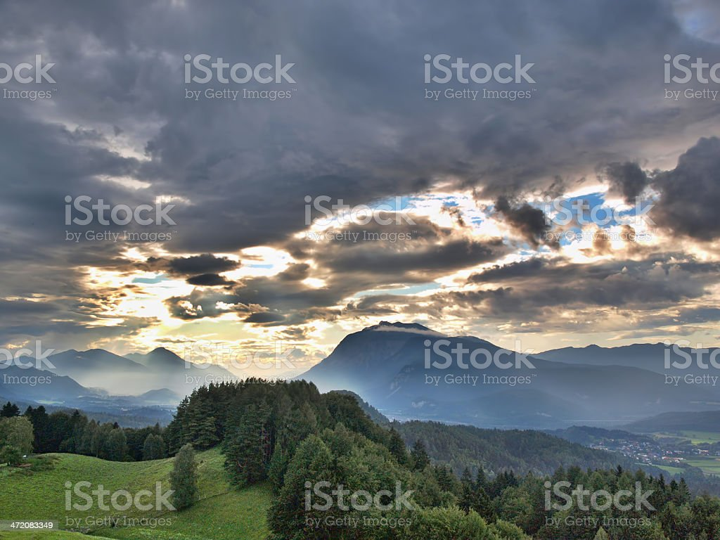 Cloudy sunset in alps royalty-free stock photo
