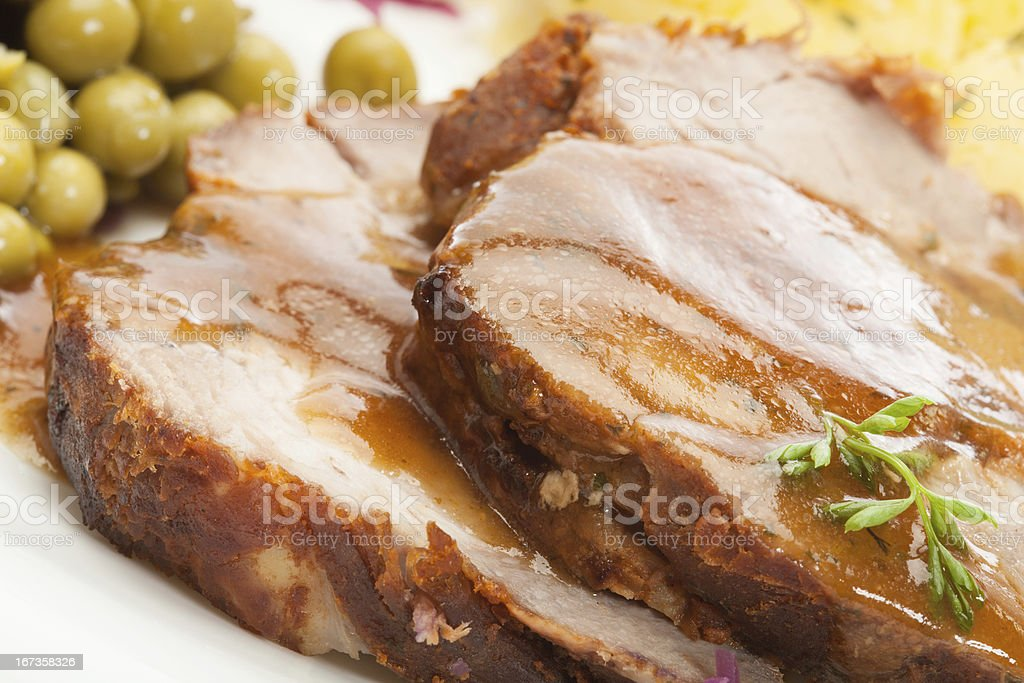 Clouse-up of roast pork with sauce stock photo