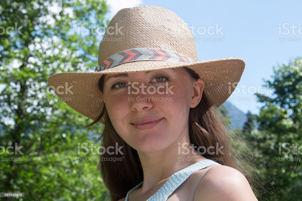 clouse-up Portrait of young pretty woman with hat in stock photo