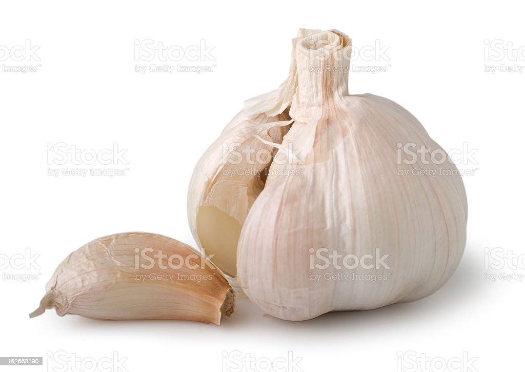 A clove of garlic next to whole garlic royalty-free stock photo