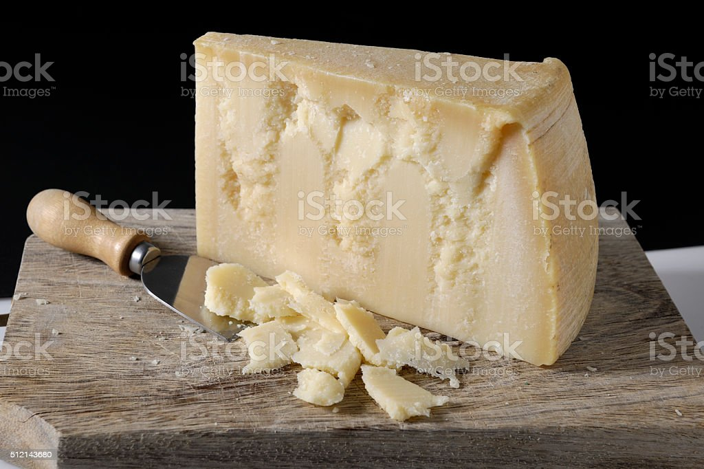 Clove of Italian hard cheese stock photo
