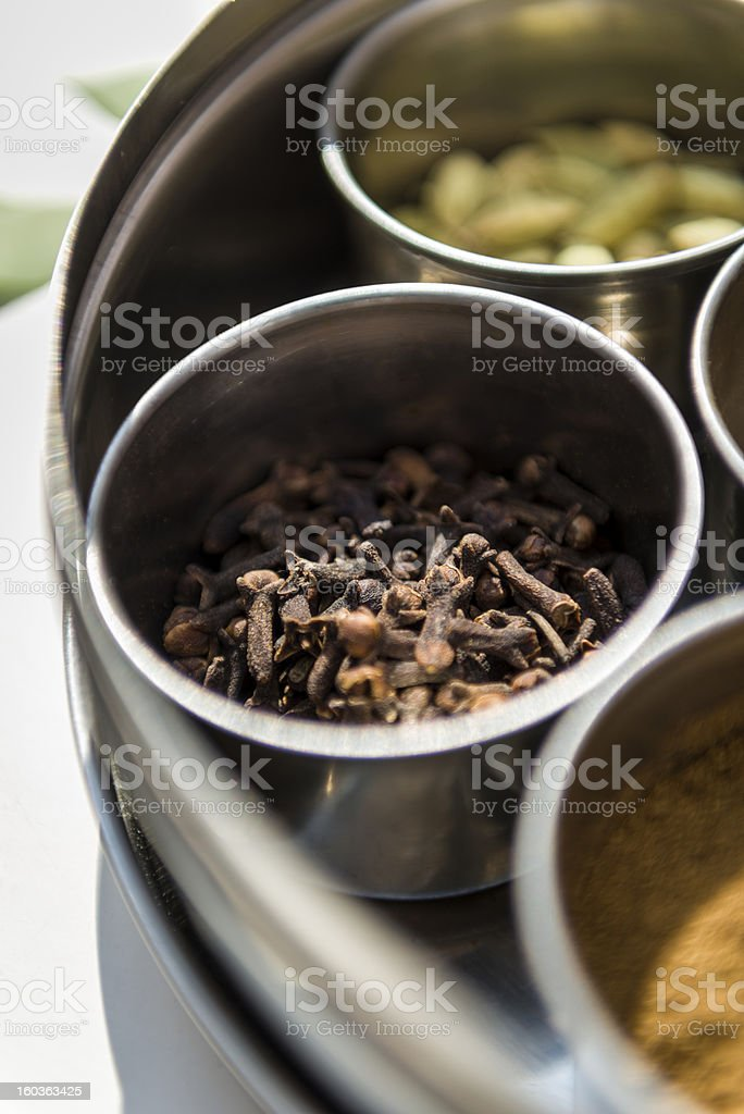 Cloves in metal bowl royalty-free stock photo