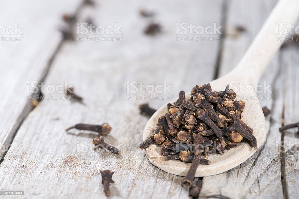 Cloves on a wooden spoon stock photo