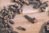 Cloves on wood background with faded effect