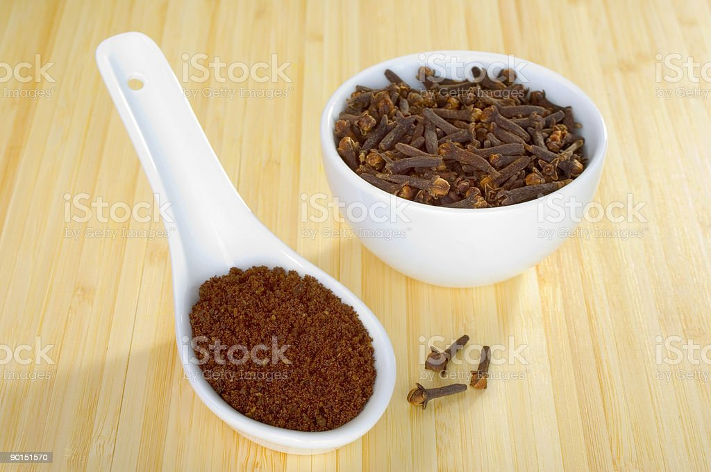 Cloves Whole and Ground royalty-free stock photo